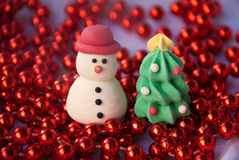 Etnika. Figures of New year tree and Snowman with red garland. New year card. Merry christmas background. Xmas postcard stock image