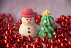 Etnika. Figures of New year tree and Snowman with red garland. New year card. Merry christmas background. Xmas postcard Stock Images