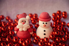 Etnika. Figures of Santa Claus and Snowman with red garland. New year card. Merry christmas background. Xmas postcard royalty free stock image