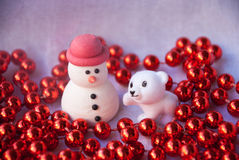 Etnika. Figures of small white bear tree and Snowman with red garland. New year card. Merry christmas background. Xmas postcard royalty free stock images