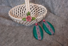 Etnika. Handmade jewelry, green earrings, interesting, made of polymer clay, african style royalty free stock images