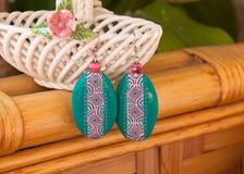 Etnika. Handmade jewelry, green earrings, interesting, made of polymer clay, green earrings royalty free stock photos