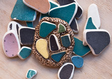 Etnika. Hanmade brooch with use of sea pebbles. Polymer clay jewellery stock images
