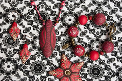 Etnika. Jewelry set ethnic style on fabric with indian ornament. Top view. Handmade jewellery of polymer clay stock photography