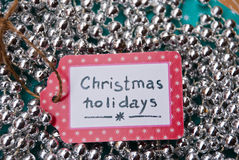 Etnika. Label  handmade On  silver garland background,  Text Christmas Holidays Royalty Free Stock Images