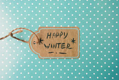 Etnika. Label  handmade On Turquoise Paper with white points,  Text Happy Winter Stock Images