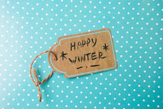 Etnika. Label  handmade On Turquoise Paper with white points,  Text Happy Winter Royalty Free Stock Photo