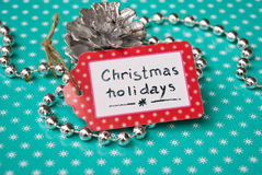 Etnika. Label  handmade On Turquoise Paper with white Snowflakes and silver garland and pine, Text Christmas holidays, New year event Royalty Free Stock Images