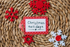 Etnika. Label  handmade on wattled straw support with red snowflakes , Text Christmas holidays, New year event Stock Images