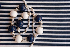 Etnika. Marine beads white blue with pearls in scandinavian style. Handmade jewelry of polymer clay royalty free stock photography