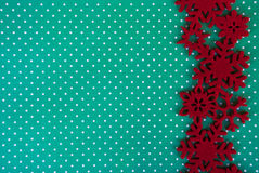 Etnika. New year background with red  snowflakes on green paper. Christmas card idea.Space for text.Xmas blank Royalty Free Stock Photo