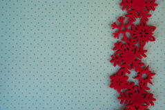 Etnika. New year background with red  snowflakes on green paper with white points. Christmas card idea.Space for text.Xmas blank Stock Image