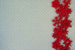 Etnika. New year background with red  snowflakes on light  green paper with points. Christmas card idea.Space for text.Xmas blank Royalty Free Stock Photography