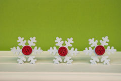 Etnika. New year background with snowflakes on green wall. Christmas card idea Royalty Free Stock Images