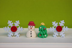 Etnika. New year background with snowflakes, new year tree and snowman on green wall. Christmas card idea.Space for text. Corporative postcard Stock Image