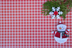 Etnika. New year background with xmas tree, snowflake and  snowman on red paper plaid. Christmas card idea.Space for text.Xmas blank Stock Photography