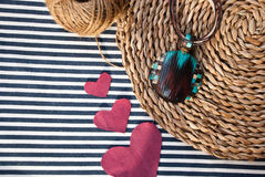 Etnika. Pendant and hearts on striped fabric. Handmade jewelry of polymer clay. Unique gift. Valentine day royalty free stock photo
