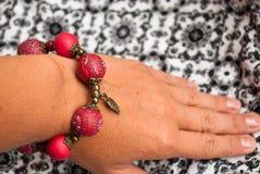 Etnika. Pink bracelet on woman wrist. Hand with bangle of polymer clay. Handmade jewelry stock photo