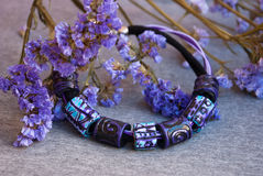 Etnika. Purple jewelry necklace with flowers. Wallpaper beautiful.Handmade jewelry beads of polymer clay stock images