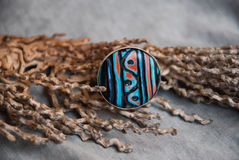 Etnika. Ring in african style with beautiful branch. Handmade jewelry of polymer clay royalty free stock photo