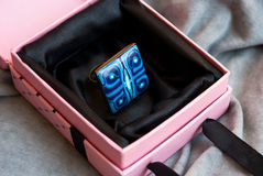 Etnika. Ring in african style in present box. Handmade jewelry of polymer clay royalty free stock photos
