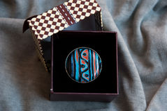 Etnika. Ring in ethnic style in present box. Handmade jewelry of polymer clay stock image