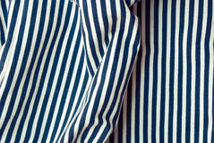 Etnika. Ð¡rumpled fabric texture striped marine, blue and white. Abstract wallpaper royalty free stock photo