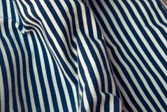 Etnika. Ð¡rumpled fabric texture striped marine, blue and white. Abstract wallpaper stock photos
