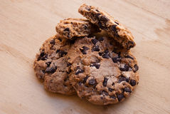 Etnika. Stacked chocolate chip cookies on wooden table royalty free stock image