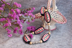 Etnika. Still life of bright tribal jewelry pink beads in african style. Handmade necklace of polymer clay stock photography