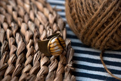 Etnika. Still life with bronze ring. Background with jewelry. Handmade jewelry of polymer clay royalty free stock photos
