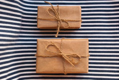 Etnika. Two parcels on striped fabric. Background sea stock photography