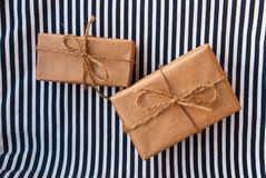 Etnika. Two parcels on striped fabric. Background sea stock photo