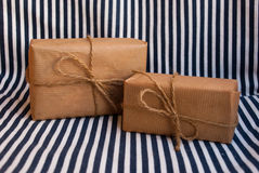 Etnika. Two parcels on striped fabric. Background sea marine royalty free stock photo