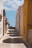 Etnika. Typical colored houses on Tabarka Spain.Mediterranean street. Narrow street stock photography