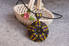 Etnika. Violet jewelry, handmade jewelry, floral necklace, pendant of polymer clay with ceramic vase royalty free stock image