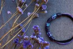 Etnika. Wallpaperpurple jewelry necklace with flowers. Handmade beads of polymer clay stock photos