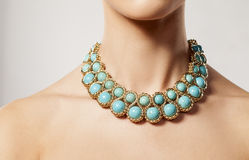 Eton blue necklace. Luxury eton blue necklace on woman's neck Royalty Free Stock Image
