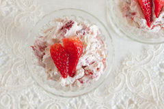 Eton Mess. A traditional English summer dessert made with strawberries raspberries meringue and cream top down view Stock Photography