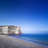 Etretat Aval cliff landmark and its beach. Night photography. Normandy, France. Stock Images
