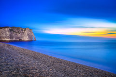 Etretat Aval cliff landmark and its beach. Twilight photography. Normandy, France. Royalty Free Stock Photo