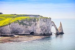 Etretat Aval cliff and rocks landmark and blue ocean . Normandy,. Etretat Aval cliff, rocks and natural arch landmark and blue ocean. Aerial view. Normandy Royalty Free Stock Photography
