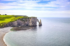 Etretat Aval cliff and rocks landmark and blue ocean . Normandy, Royalty Free Stock Image