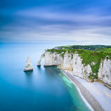 Etretat Aval cliff and rocks landmark and ocean . Normandy, France. Etretat Aval cliff, rocks and natural arch landmark and blue ocean. Aerial view. Normandy Stock Photo