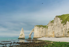 Etretat Aval cliff, rocks and natural arch landmark and blue oce Stock Images