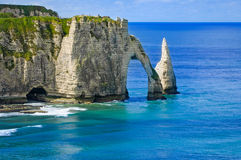 Etretat Aval cliff and rocks landmark and blue ocean . Normandy, France. Royalty Free Stock Photography