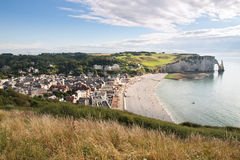 Etretat city in Normandy France. View of a cliff and Etretat city in Normandy with its pebble beach royalty free stock image
