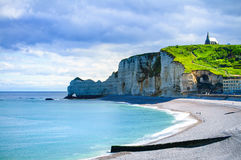 Etretat cliff, church landmark and beach on morning. Normandy, F Royalty Free Stock Photos