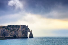 Etretat cliff in Normandy, France. Etretat cliff at sunset in Normandy, France Stock Image