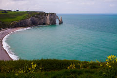 Etretat cliffs, France. Etretat  chalk cliffs, including three natural arches and a pointed formation called L`Aiguille or the Needle.  Seine-Maritime department Stock Photo